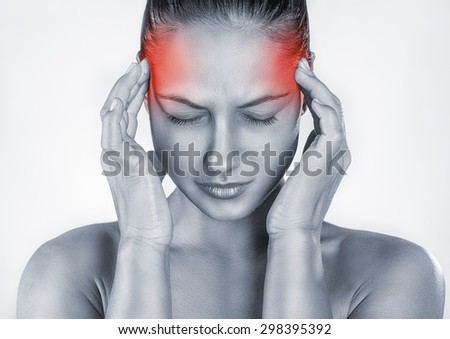 Woman with headache isolated on white background - stock photo