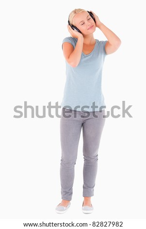 Woman with headphones having eyes closed in a studio