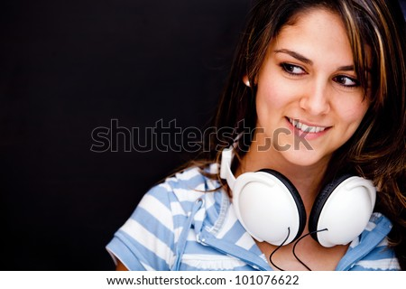 Woman with headphones - isolated over a black background