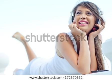 Woman with headphones listening music .  - stock photo