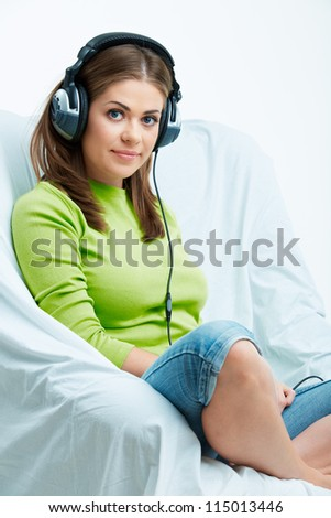 Woman with headphones listening music .Music teenager girl against isolated white background - stock photo