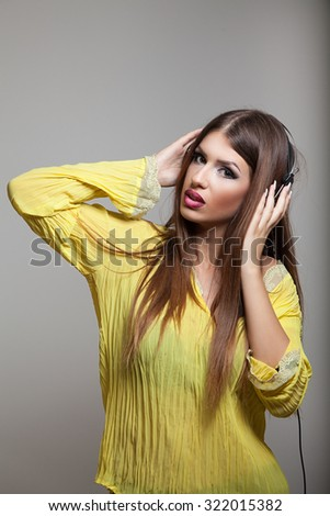 Woman with headphones listening music .Music teenager girl dancing against isolated background - stock photo