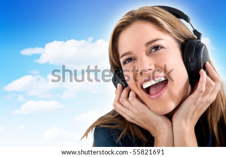 Woman with headphones with a blue sky on the background