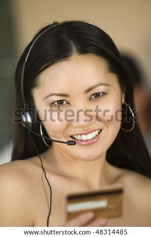 Woman with Headset and Credit Card
