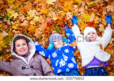woman with her childrens in park - stock photo