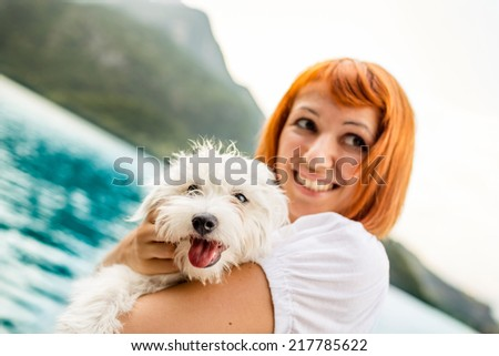 Woman with her dog during a day on Lake