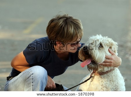 Woman with her dog in the park - stock photo