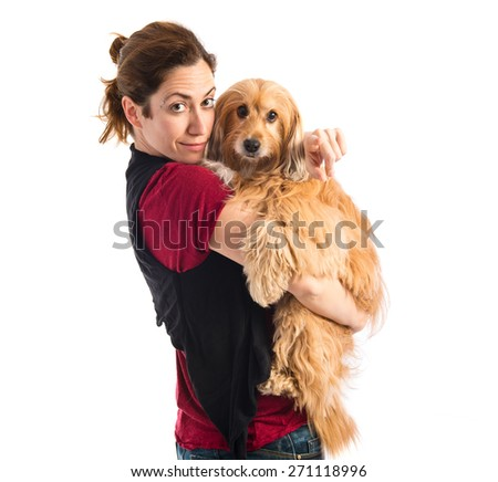Woman with her dog pointing to the front