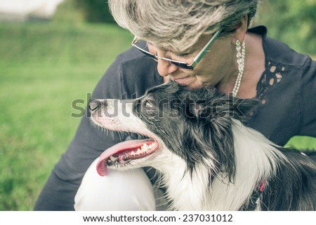 woman with her dog sharing emotions. concept about animals and pets - stock photo