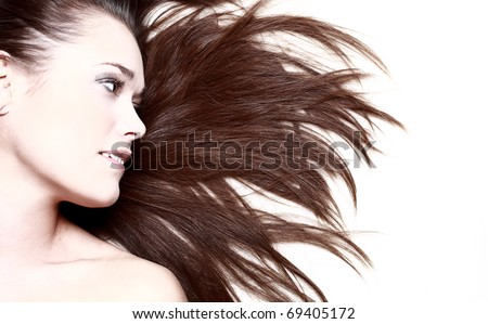 woman with her hair blowing and smiling - stock photo