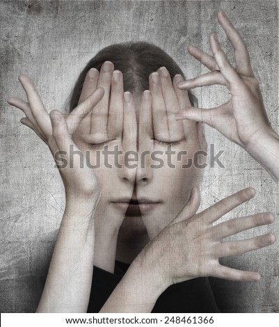 Woman with her hands on the grunge background.  Surreal concept photo manipulation - stock photo