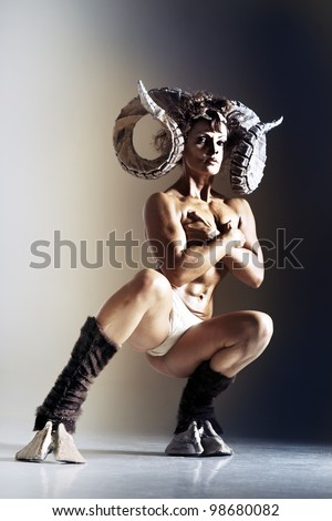 woman with horns - stock photo