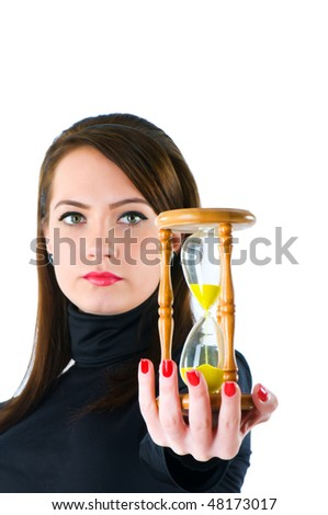 Woman with hourglass isolated on the white - stock photo