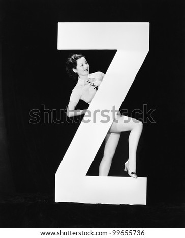 Woman with huge letter Z - stock photo