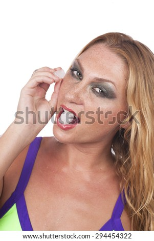 Woman with ice cube on her cheek isolated
