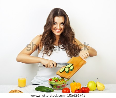 woman with knife and board - stock photo