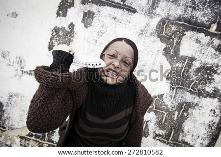 Woman with knife robber, violence and fear - stock photo