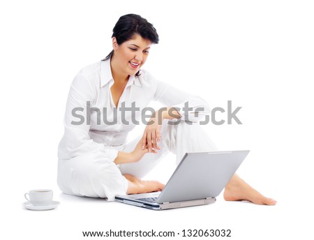 Woman with laptop and cup - stock photo