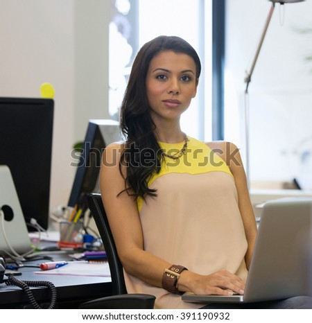 woman with laptop in office - stock photo