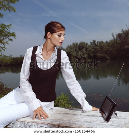 woman with laptop in park - stock photo
