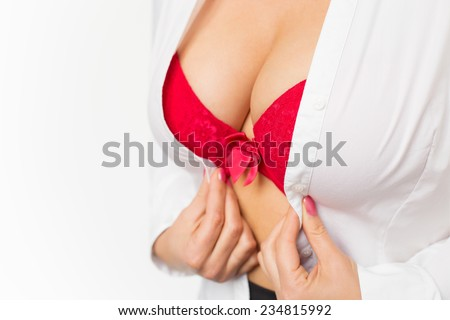 Woman with large breasts wearing red bra and white shirt - stock photo