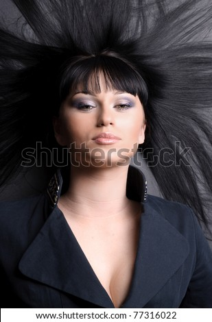 Woman with long black hair lying down - stock photo