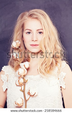 Woman with long blond curly hair - stock photo