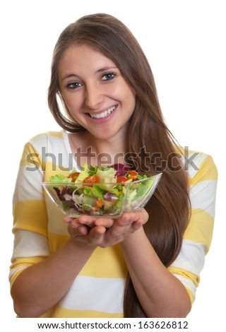 Woman with long brown hair loves salad