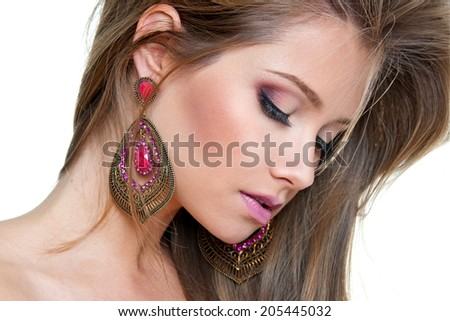 woman with long hair and big fashion pink earring - stock photo
