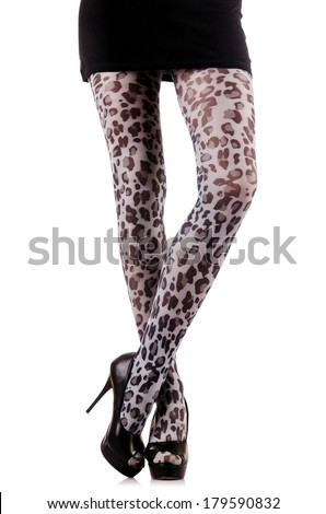 Woman with long legs and stockings - stock photo