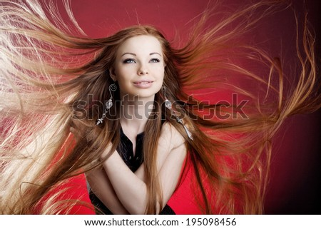 Woman with long luxury hair - stock photo