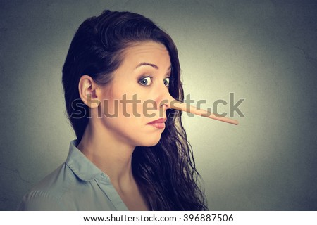 Woman with long nose isolated on grey wall background. Liar concept. Human face expressions, emotions, feelings