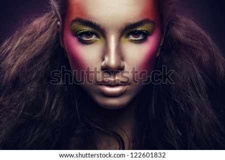 woman with magnificent hair and colorful make up - stock photo