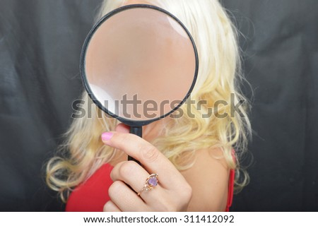 Woman with Magnify Glass - stock photo