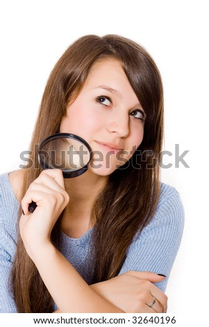 Woman with magnifying glass on a white background.