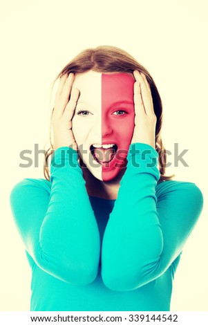 Woman with Malta flag painted on face. - stock photo