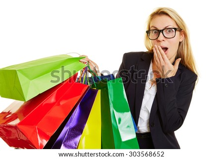 Woman with many shopping bag acting surprised over amazing discount prices - stock photo