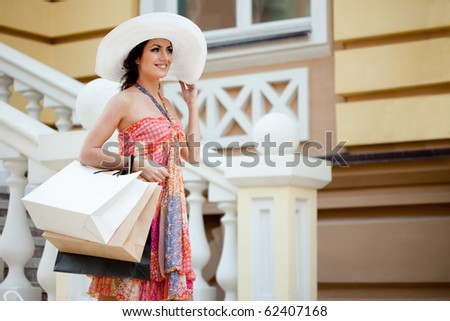woman with many shopping bags - stock photo