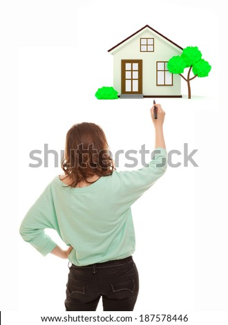 Woman with marker drawing house of her dreams - stock photo