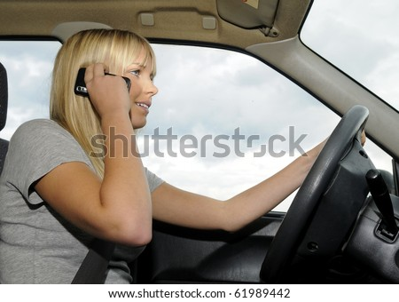 woman with mobile phone in the car - stock photo
