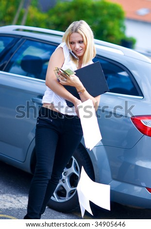 woman with mobile phone laptop money and documents in stress - stock photo