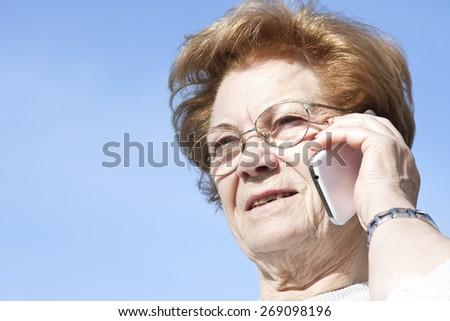 woman with mobile phone outdoors - stock photo