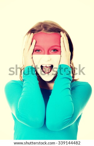 Woman with Monaco flag painted on face. - stock photo