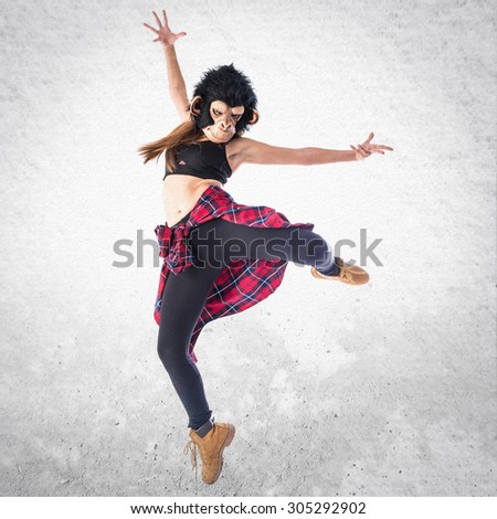 Woman with monkey mask dancing