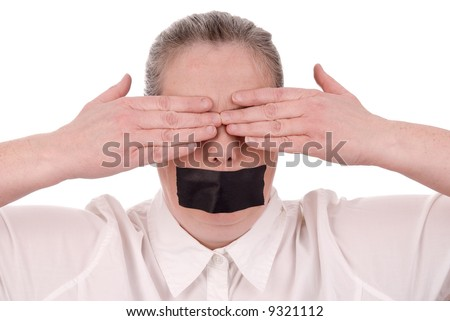 Woman with mouth taped and hands over her eyes closed over a white background - stock photo