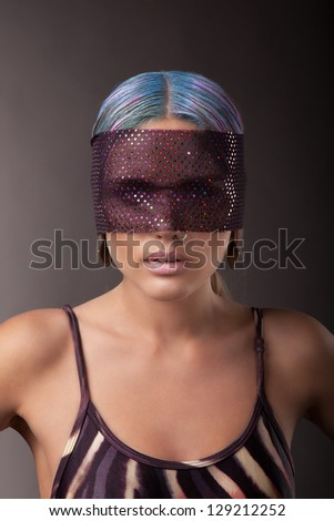 woman with multicoloured hair and blindfold, indoor - stock photo