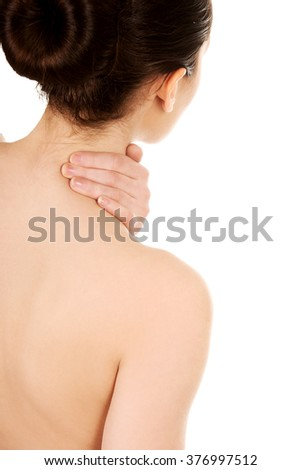 Woman with neck pain from behind.