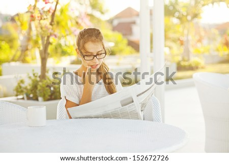 woman with newspaper - stock photo