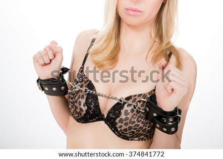 Woman with nice breasts with handcuffs, white background, isolated.