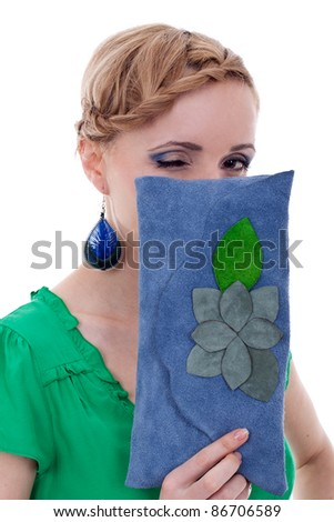 woman with nice earrings and purse winking for the camera - stock photo